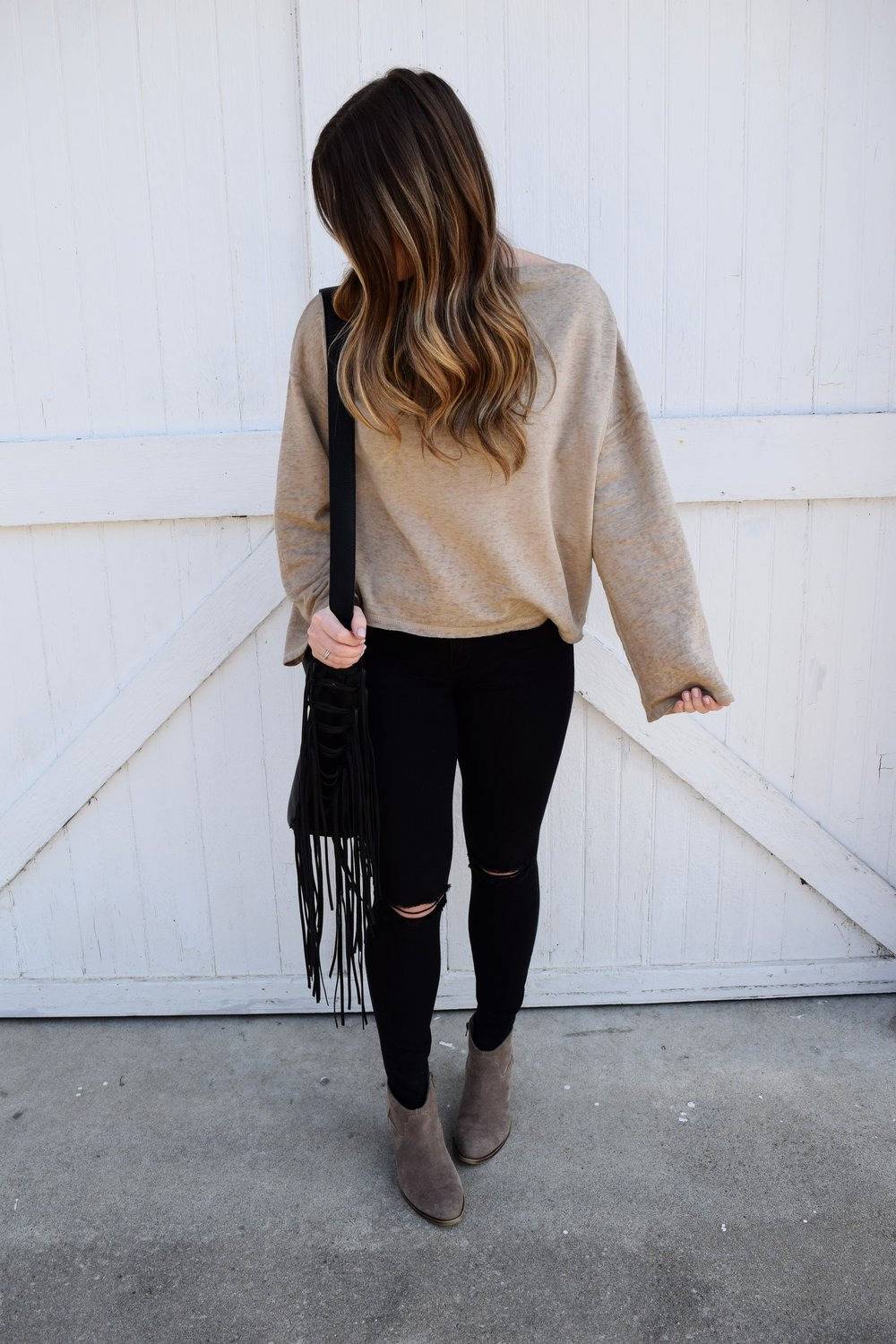 off the shoulder sweater + black denim