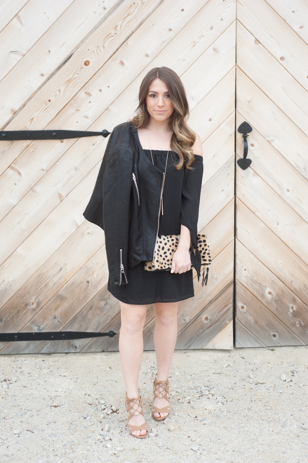 off the shoulder black dress + leather moto jacket / spring transition outfit