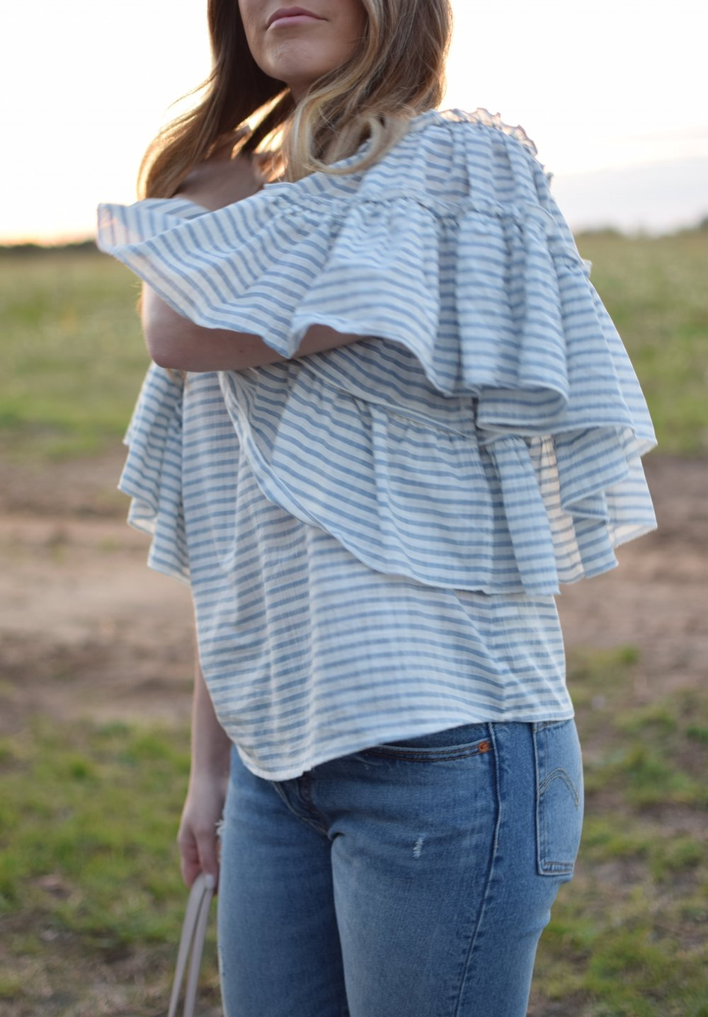 striped ruffle sleeve top / high waisted denim / spring outfit idea