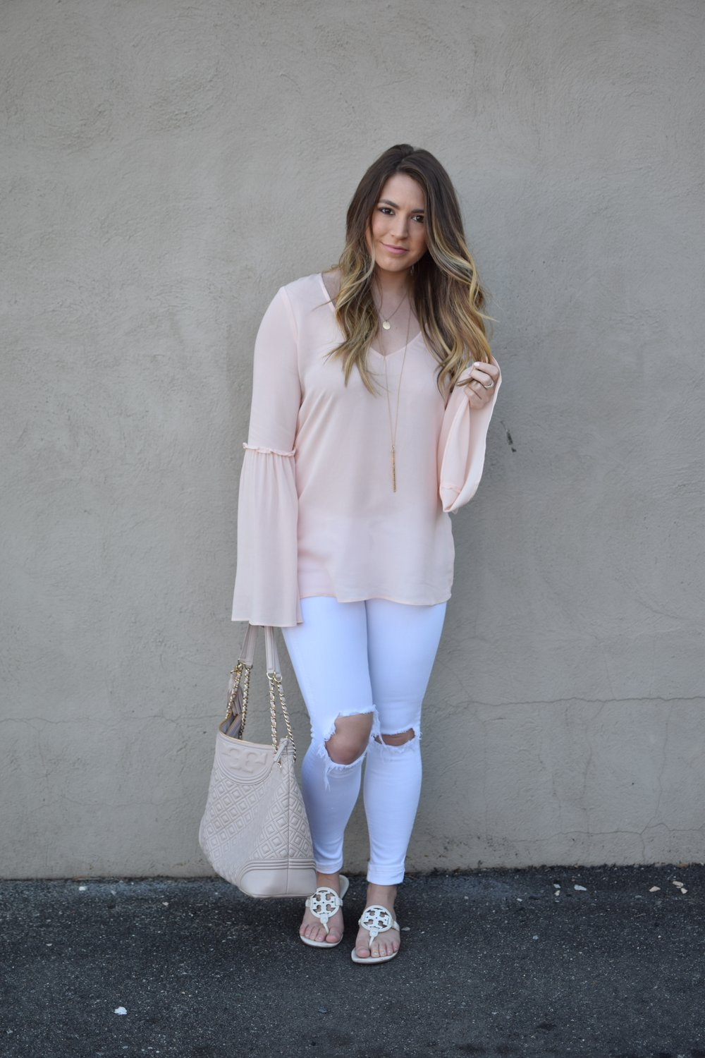 blush bell sleeve top & white distressed denim / tory burch miller sandal / spring outfit idea