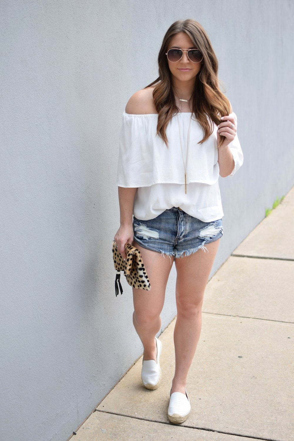 white off the shoulder top / denim cutoffs / white espadrilles / leopard clutch