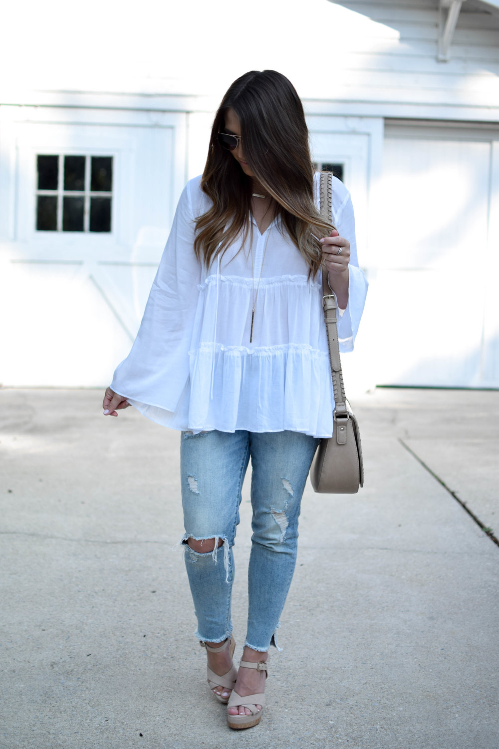 loft flowy white top, light wash distressed denim, aldo nude wedges, sole society cross body bag, summer outfit idea