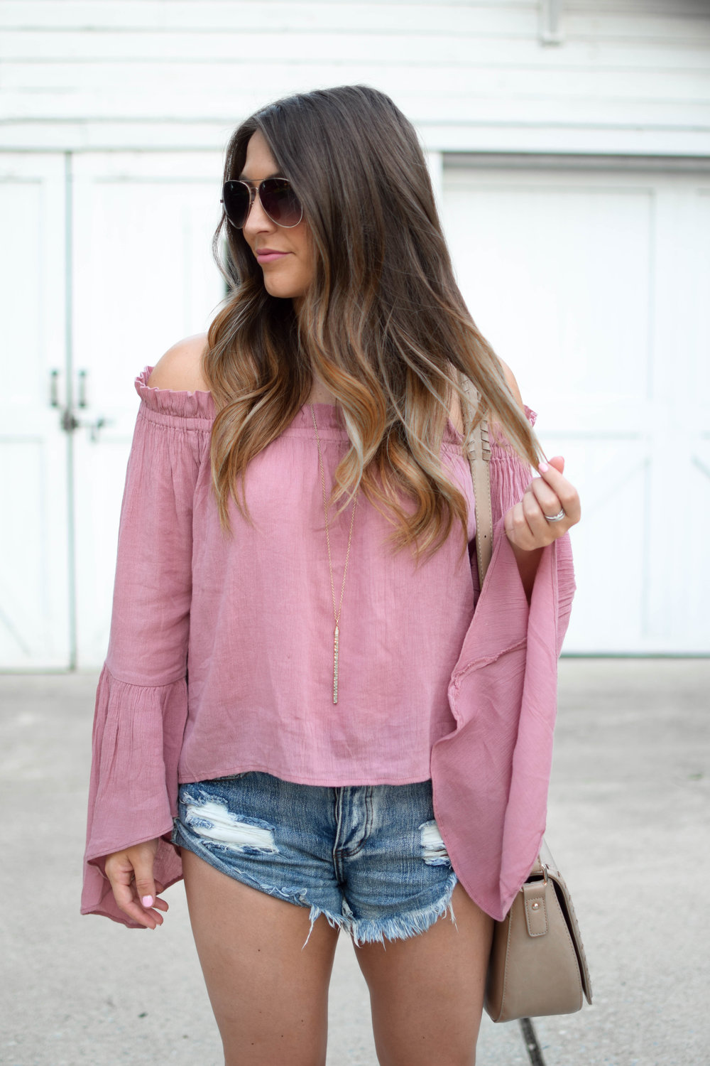 off the shoulder top, one teaspoon denim cutoffs, sole society cross body bag, Steve Madden slides, summer outfit idea, fall transition outfit idea