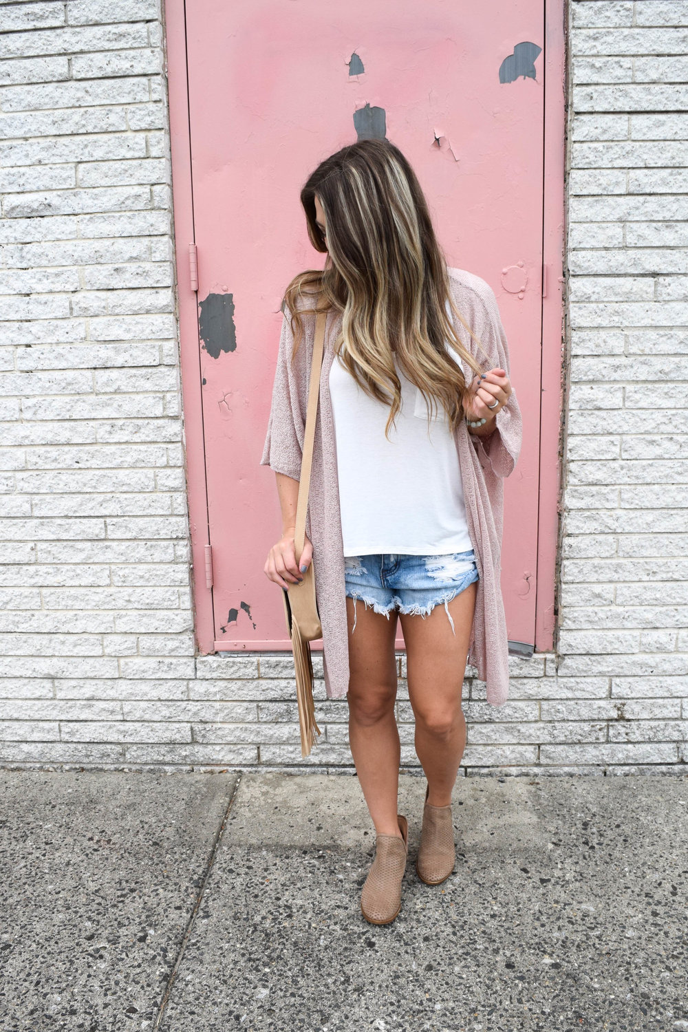 fall outfit idea / how to transition shorts into fall / white tee + denim cutoffs