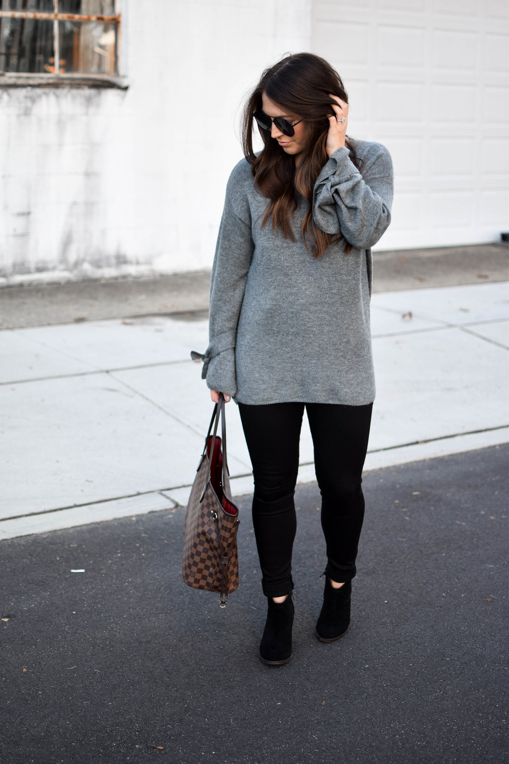 fall fashion / fall outfit idea / fall outfit inspiration / fall closet essentials / black denim / black booties / tie sleeve sweater
