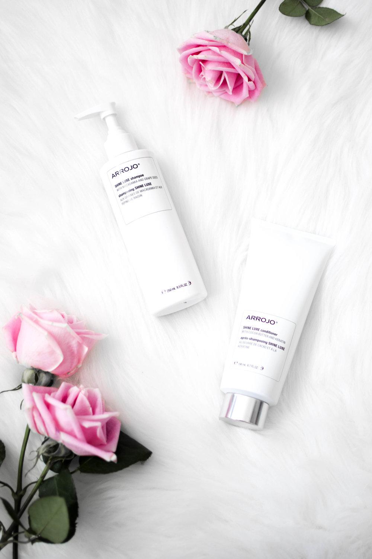 beauty product flat lay / arrojo hair care / arrojo shine luxe shampoo & conditioner