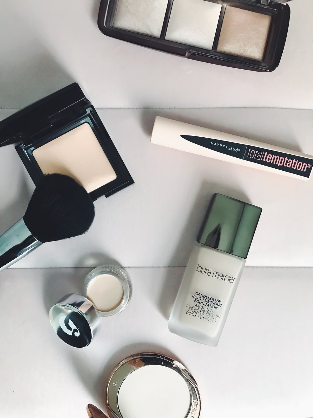 Recent Beauty Buys | Pine Barren Beauty | Laura Mercier foundation, Charlotte Tilbury setting powder, Laura Mercier setting powder, Maybelline mascara, Glossier concealer, Hourglass ambient light palette, beauty product review, beauty product flat lay