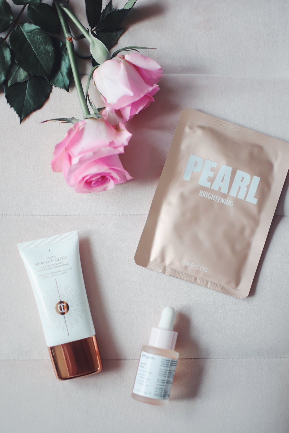 Charlotte Tilbury Healthy Glow Tinted Moisturizer Review | Pine Barren Beauty | the best tinted moisturizer, beauty product review, beauty product flat lay, Charlotte Tilbury