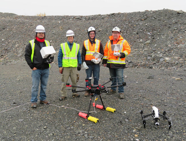 A crew from Hatch shows off some of the drone equipment used for water sampling in pit lakes.
