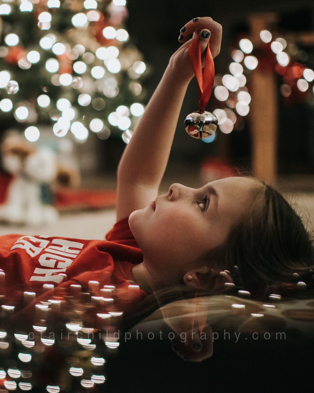 "My daughter, taken in December, while watching ""The Polar Express""."
