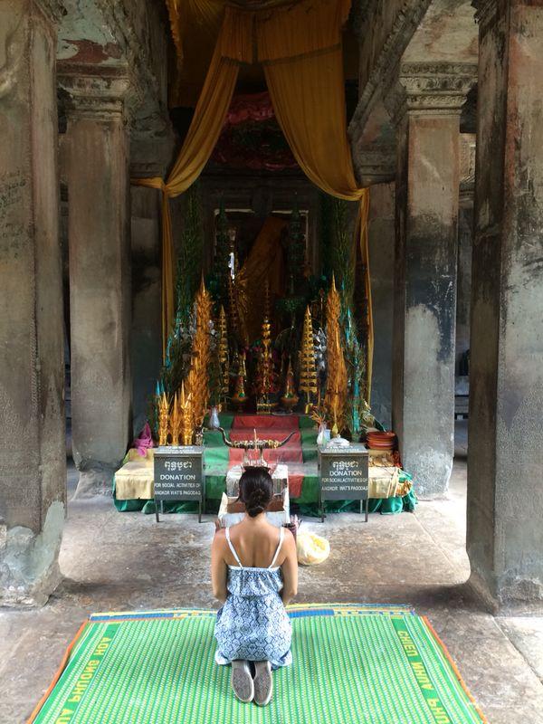 Rebecca praying in Cambodia