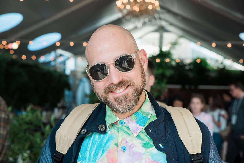 CHRIS ADAMO The Hawaiian shirts drew us in, his passion for engagement with local communities sealed the deal. His day gig, Whereby.us, is a collective of storytellers and community creators by trade that are bridging the local media gap, one city at a time.