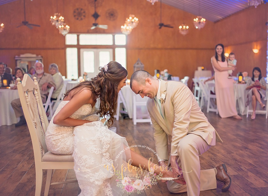 bride-groom-wedding-day-married-garter-toss-reception-fun-ashelynn-manor-naughty-woodlands-tx-houston-area-photography.jpg
