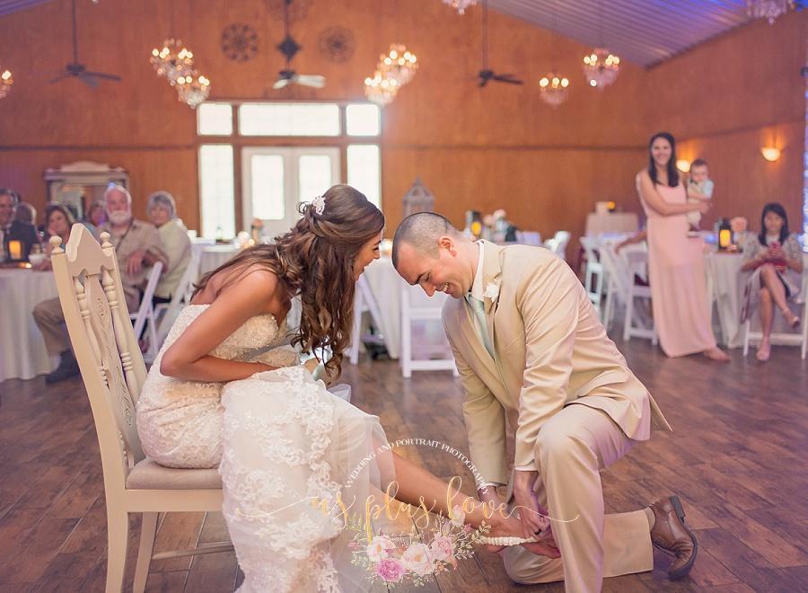 bride-groom-wedding-day-married-garter-toss-reception-fun-ashelynn-manor-naughty-woodlands-tx-houston-area-photography.jpg