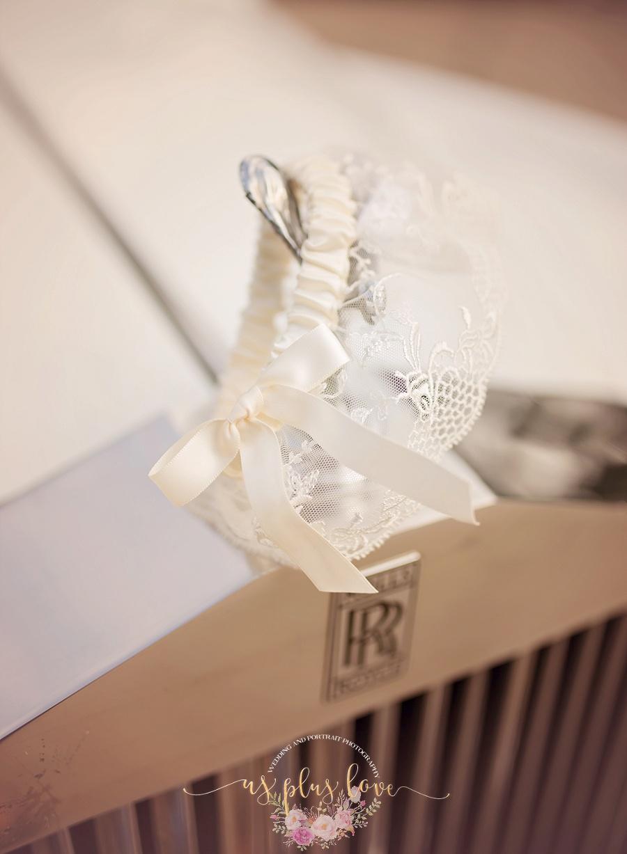 rolls-royce-garter-naughtty-suggestive-sweet-romantic-honeymood-bound-getaway-car-ashelynn-manor-wedding-photos.jpg