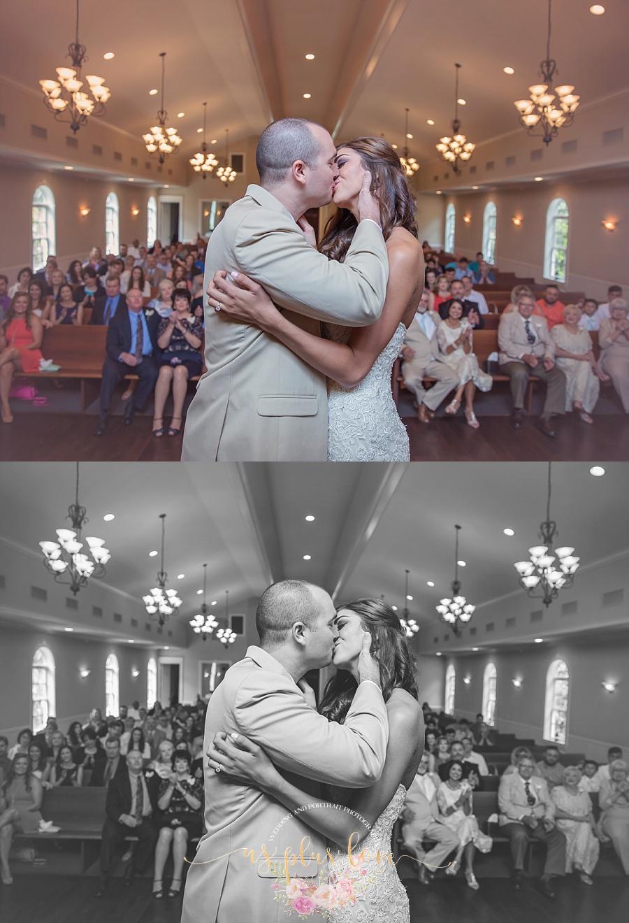 wedding-photographer-houston-area-the-woodlands-tx-77381-magnolia-venue-ashelynn-manor-bride-groom-kiss-first-family-love-moment-i-do-black-and-white.jpg
