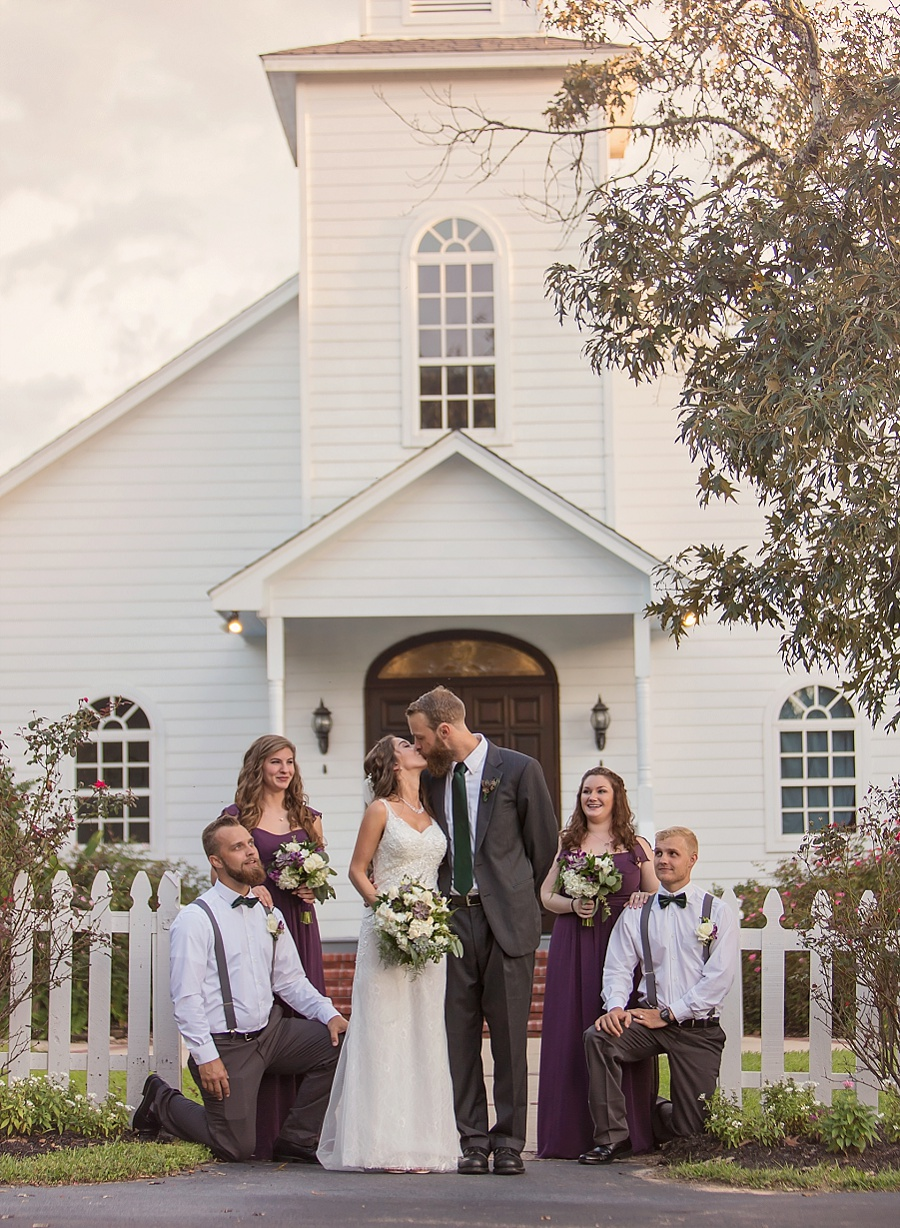 bridal-party-kiss-chapel-ashelynn-manor-plum-emerald-color-scheme-fine-art-photography-wedding-images.jpg