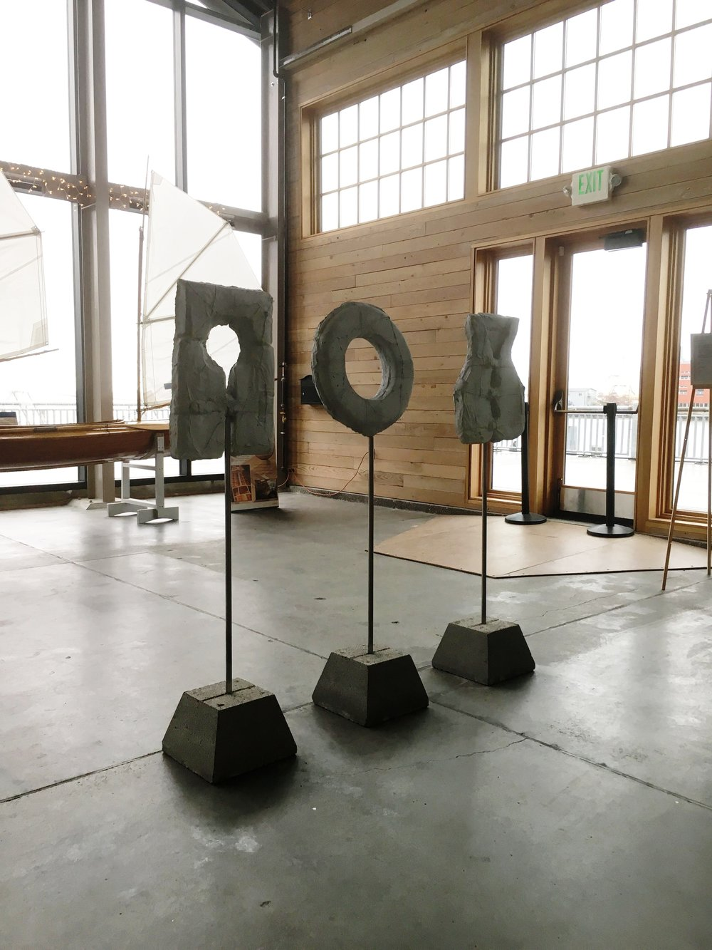 "SOS  Concrete / Steel, 48""h x 18""w x 12"" d.  Based on the Shipwrecked theme and the pre and post election of 2016, this piece ""S.O.S."" represents the feeling of helplessness and despair of those results in the moment. A new feeling has replaced that sentiment, that being of fierce resistance, rage, and action."
