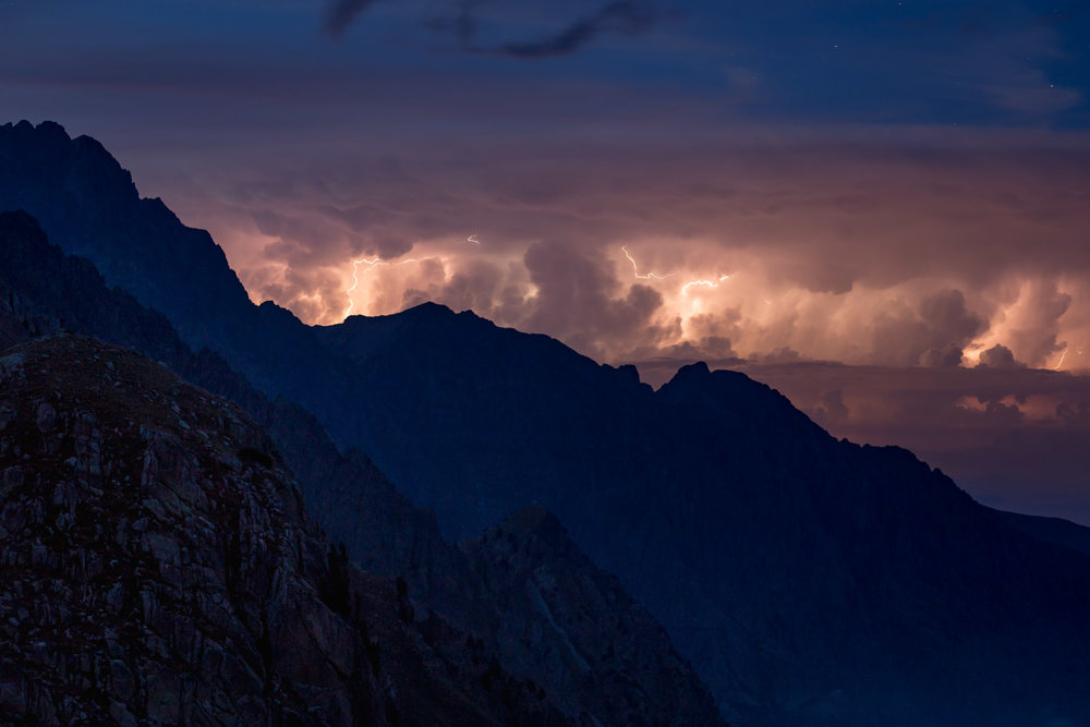 lightning storm over mountains in italian alps landscape travel unique moment.jpg