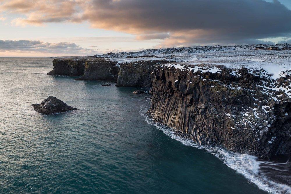 iceland snæfellsnes peninsula arnarstapi cliffs basalt columns in winter landscape travel image.jpg