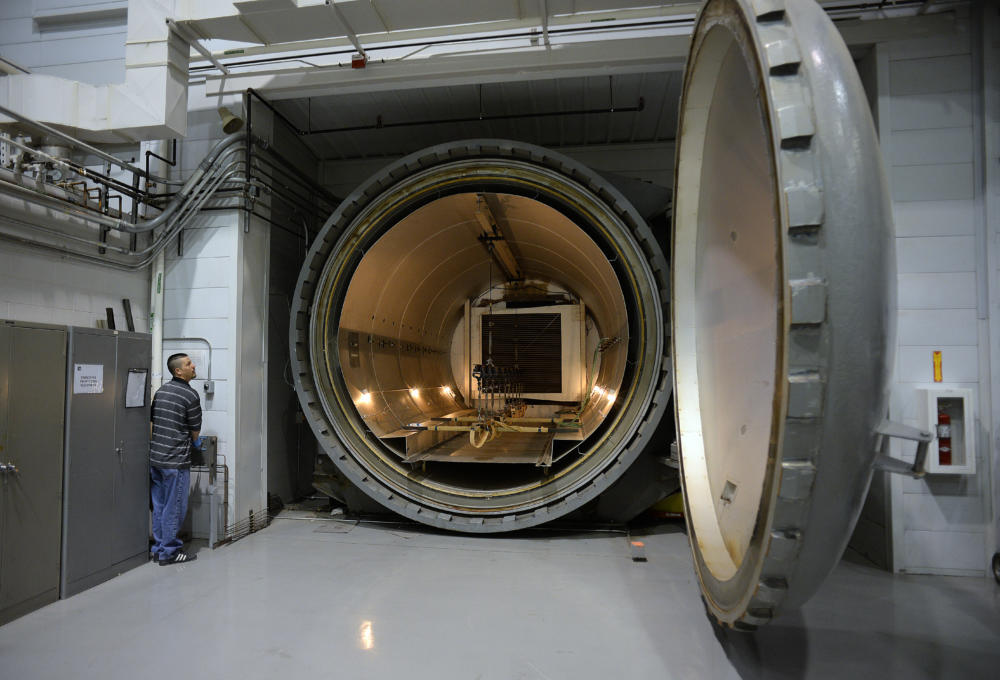 Air Force Research Laboratory employee Jeff Brumfield shows a massive autoclave at the lab's Integrated Structural Systems lab. (Adolphe Pierre-Louis/JOURNAL)