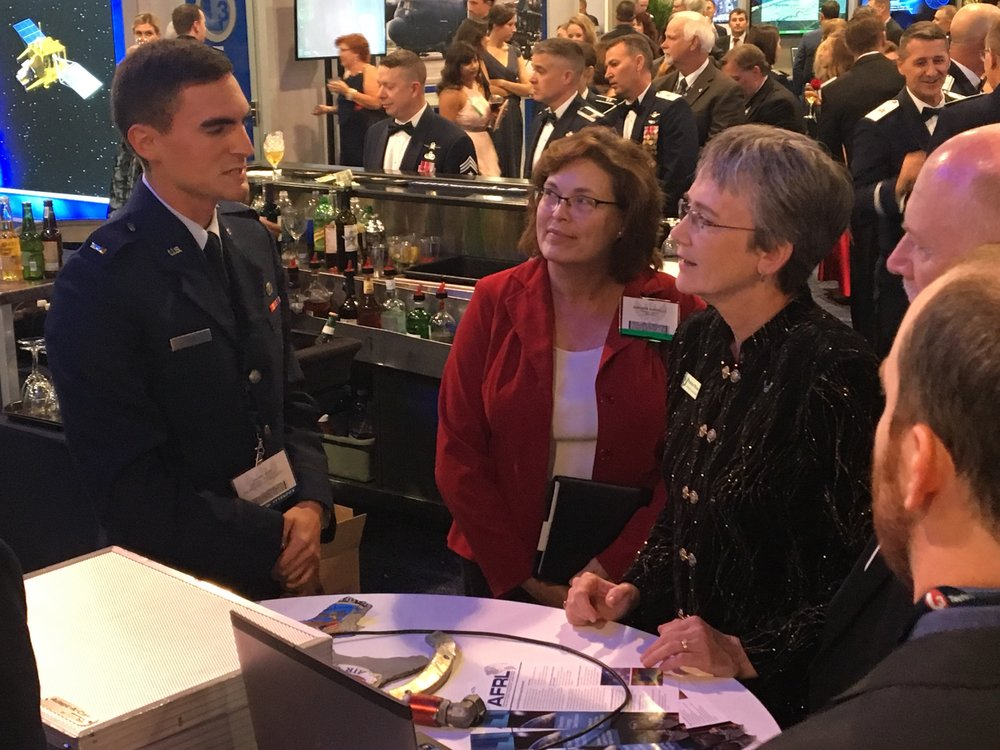 Directorate scientist 1st Lt Daniel Gum discusses high power electromagnetic technology with Secretary of the Air Force Heather Wilson.