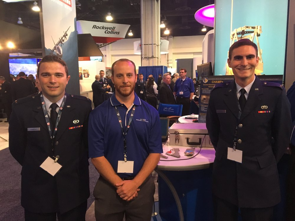 Air Force Research Laboratory Directed Energy Directorate scientists 2nd Lt Gideon Powers, Jeremy McConaha, and 1st Lt Daniel Gum at the 2017 Air Force Association Air, Space and Cyber Conference