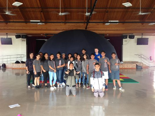 The Air Force Maui Optical and Supercomputing site STEM Outreach visit to the Maui Waena School. The photo shows the students in front to the AFRL portable, digital planetarium. The students received a tour of the night sky with a focus on stellar navigation techniques used by the Polynesian canoe Hōkūleʻa in its voyage home to Hawai'i.