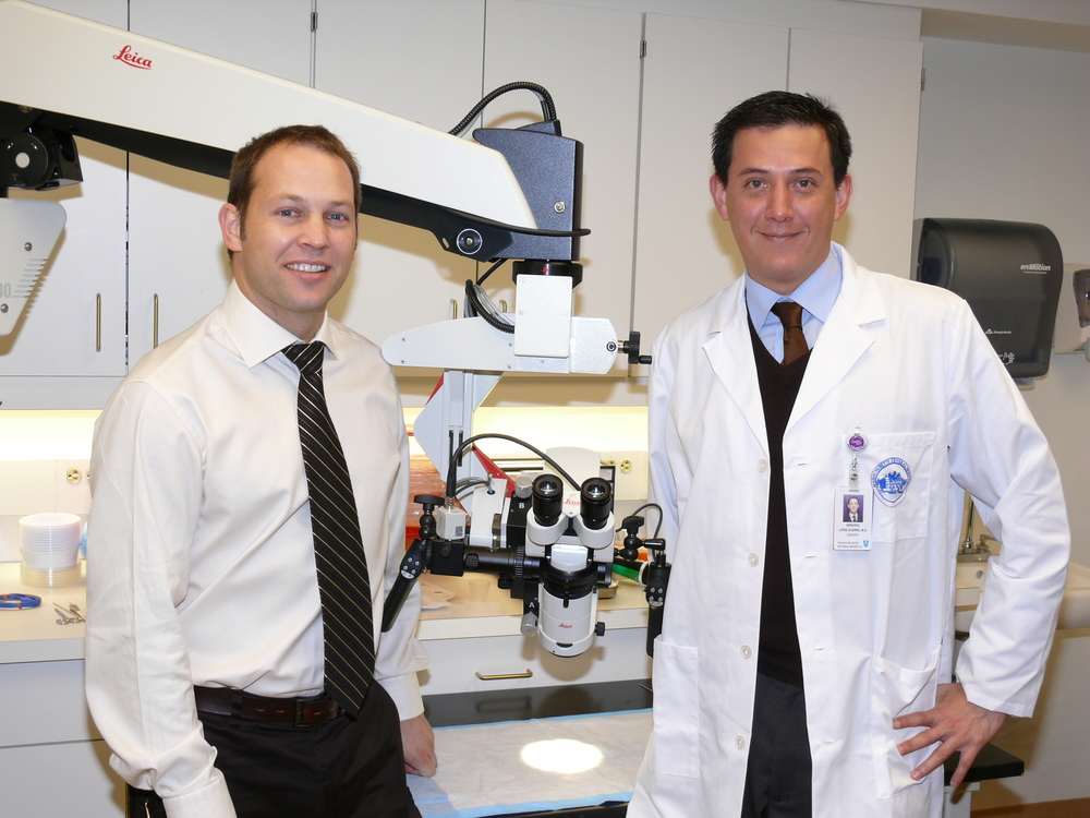 Drs. Matthew Broadhurst and Gerardo Lopez-Guerra are shown with a new research surgical microscope.