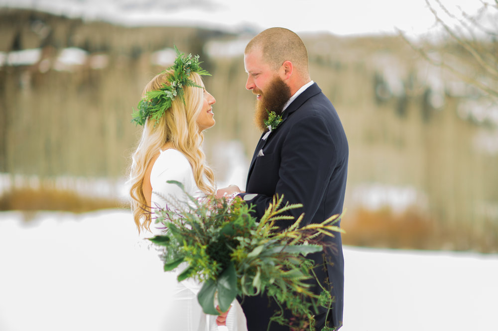 Parie Designs snow and greenery wedding.