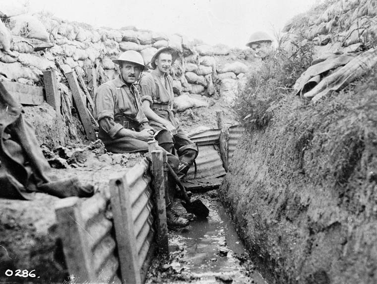 Trench maintenance. Men sitting on the 'Fire-step'.