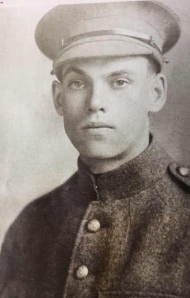 Pvt. J.H. Nicholls. The absence of cap and collar badges suggests this is a 1914 photo (the army didn't have enough of anything to go around), most likely when he was with the 18th Battalion.