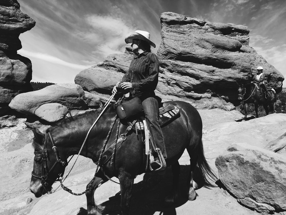 A guided horseback tour passing on the Palmer trail in Garden of the Gods park.