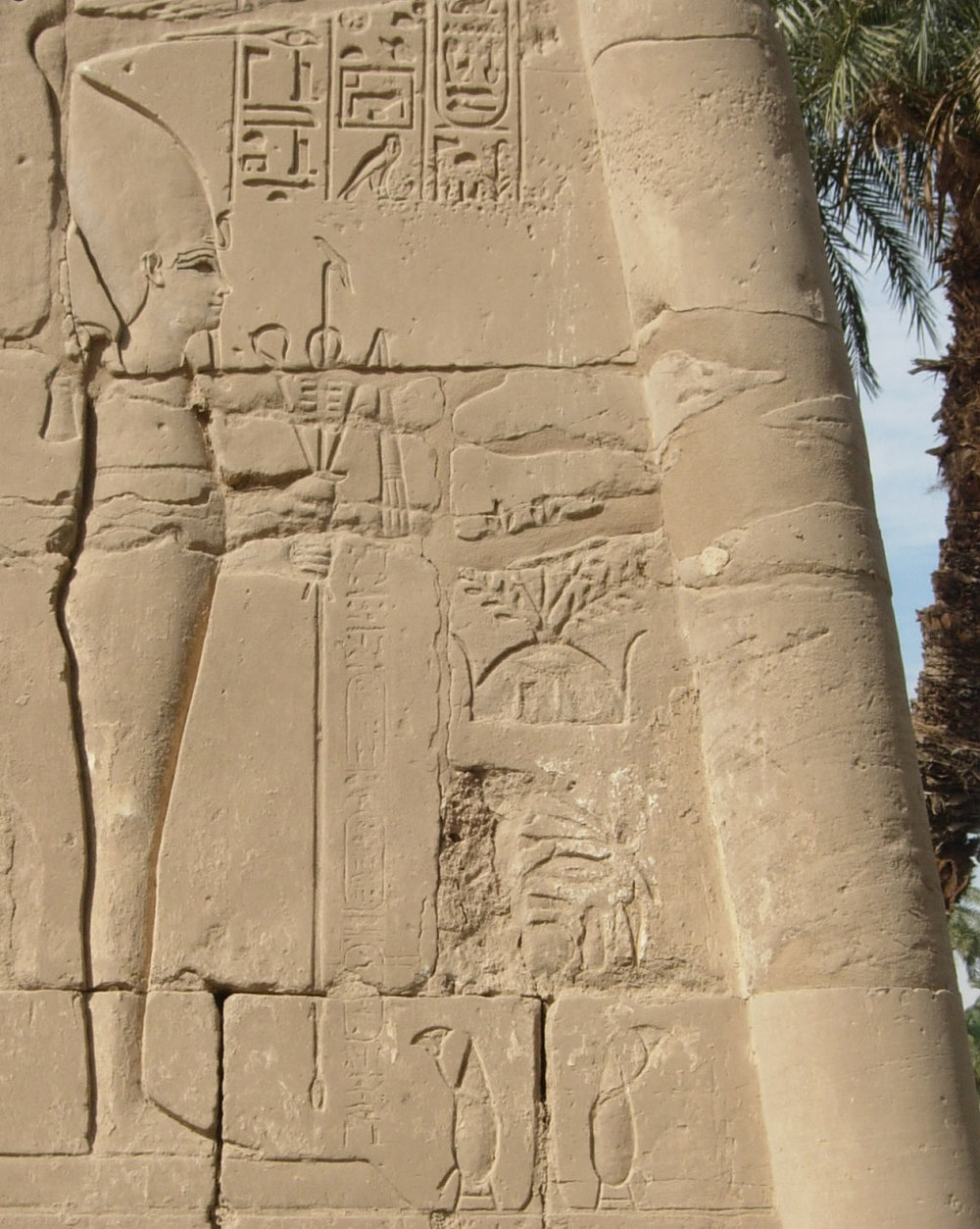 Late Period relief of Osiris, NE Karnak girdle wall showing ideogram of his tomb near center.