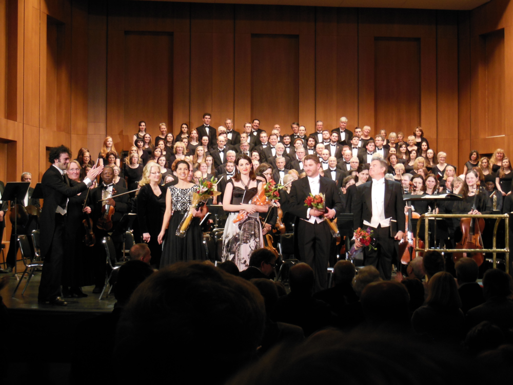 """GBS PACKS THE HOUSE AT THE KLEIN! Under conductor Eric Jacobsen, GBS performed Beethoven's Ninth Symphony on Saturday night, December 12, 2015, joined by the Mendelssohn Choir of Connecticut and the Fairfield University Chamber singers, to a sold-out house. The Ninth Symphony, with its familiar """"Ode to Joy"""" chorale, was performed with exuberance by some 57 musicians of the Greater Bridgeport Symphony, all top-flight professionals, several of whom travel thousands of miles to play in Bridgeport. The choir of 105 members sang the memorable Fourth Movement to its stunning climax. An immediate standing ovation lasted over six minutes as Maestro Jacobsen, Choirmaster Carole Anne Maxwell, and the four soloists took their bows. The sold-out house is a first in many seasons, and is part of a trend which may be attributable to the vibrant new sound of conductor Jacobsen, now in his second season with GBS. Jacobsen is a world-renowned conductor and cellist, based in Brooklyn, New York, who recently headlined with Yo-Yo Ma at Caramoor. His youth and electricity as a conductor are attracting a new generation to Classical music. In addition, he has brought serious modern music to GBS, most recently including up-and-coming cellist Joshua Roman in September, who soloed in a new work written for him by American composer Mason Bates. As part of its education and cultural mission, GBS provided free and reduced-price tickets to music students from Bridgeport and the region, from programs such as KEYS (Kids Empowered by Your Support), the Greater Bridgeport Youth Orchestras (GBYO), Music For Youth, and the Regional Center for the Arts, as well as from the University of Bridgeportand Fairfield University. GBS will sponsor a Youth Competition this coming spring, open to student musicians aged 11 through 18. GBS also sponsored a food drive at the concert to benefit the Bridgeport Rescue Mission. Patrons responded enthusiastically, and the Mission's volunteers reported that their van was f"""