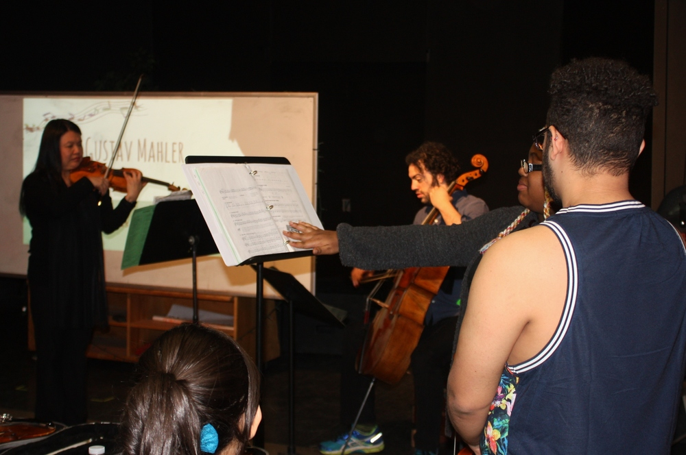 Deborah Wong and Eric Jacobsen perform for students at Central High School in Bridgeport