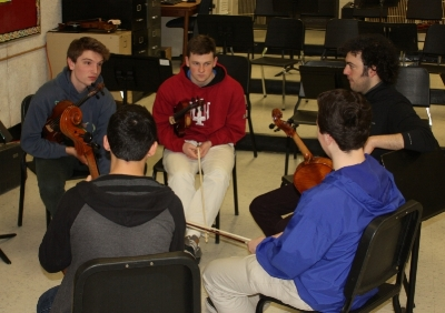 Eric discusses an upcoming TV appearance with members of the Greater Bridgeport Youth Orchestras' Principal Orchestra.