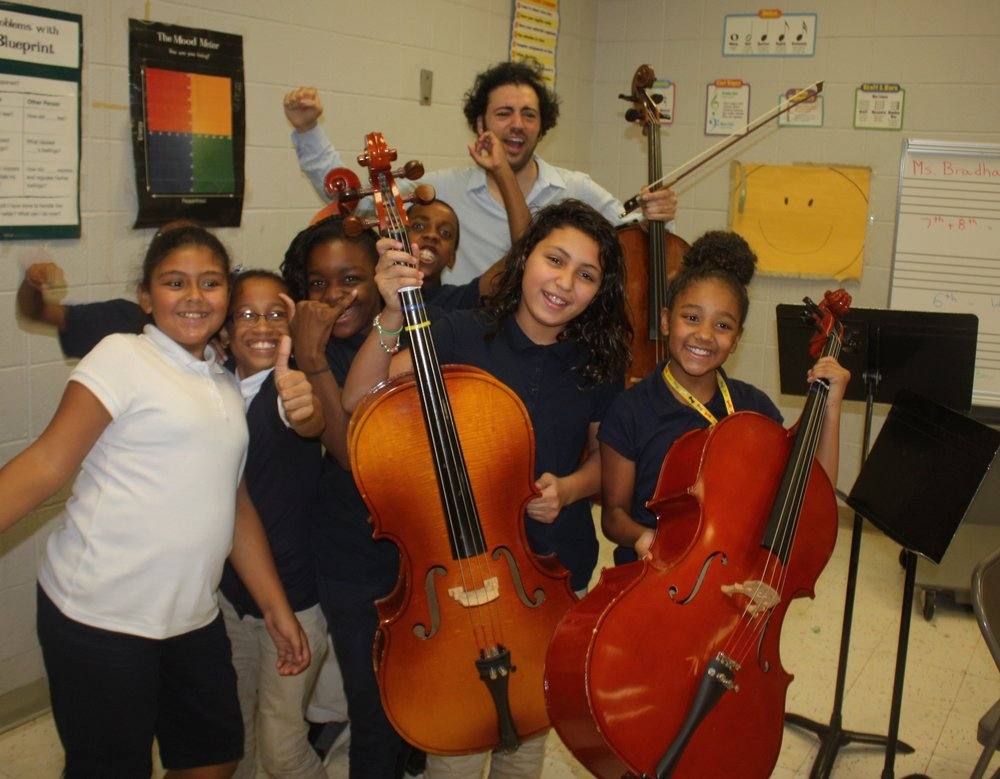 Eric makes new friends at High Horizon Magnet School in Bridgeport after a musical presentation.