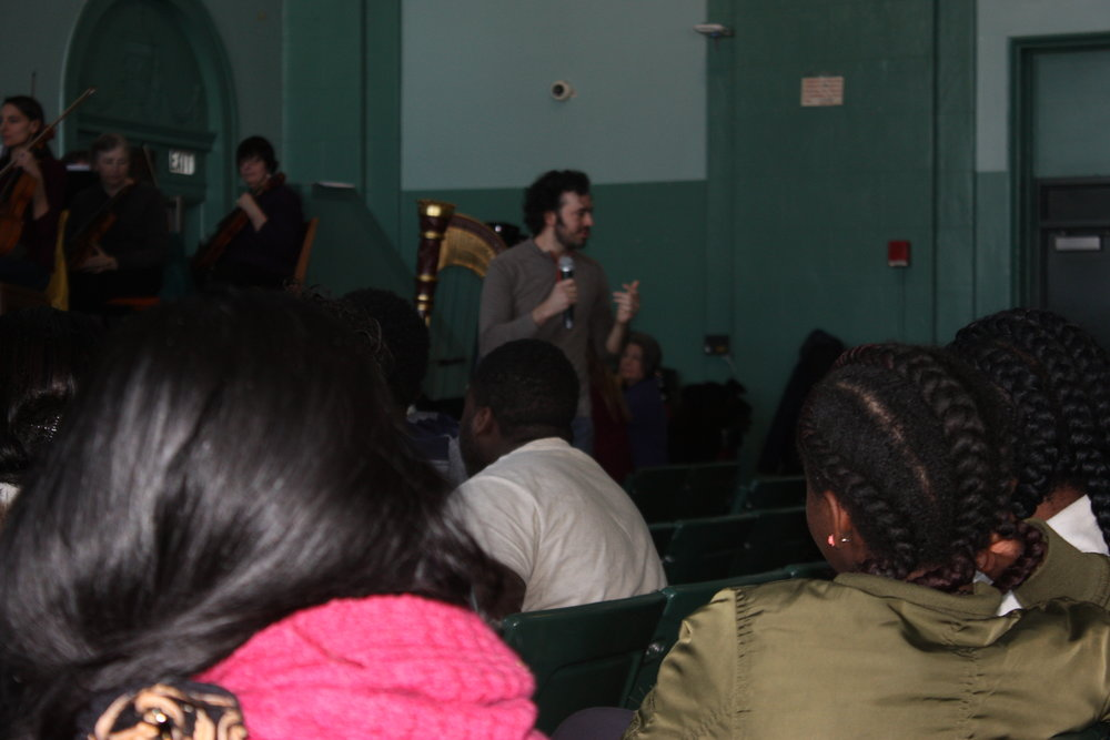 GBS rehearsed at Bridgeport's Bassick High School on March 14, 2017, and opened the doors to about 250 Bassick students. Shown here, conductor Eric Jacobsen speaks with the students about the music of Leonard Bernstein and Claude Debussy. Partial funding for this event was provided by the Hersher Family Foundation and by the City of Bridgeport.