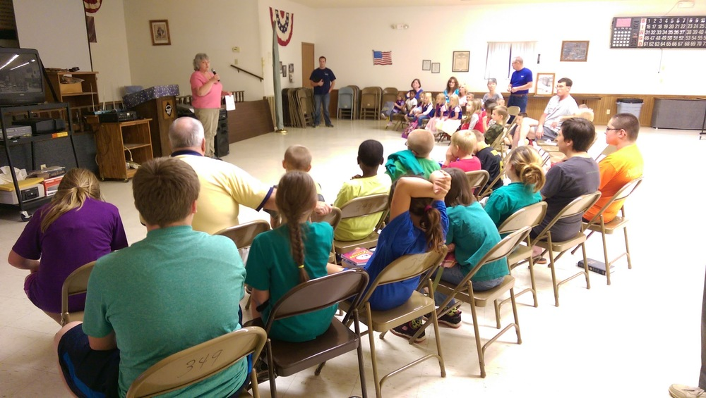 Barb Colbert sharing with the kids about missions.