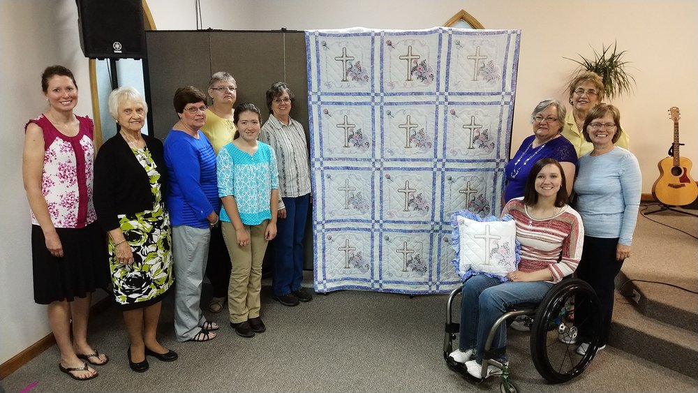 Ramsey Creek ladies who helped with the Strawberry Festival quilt.  From left to right: Amy Brown, Bonnie Stone, Ruth David, Debbie Wheeler, Faith Brown, Carolyn Maupin, Becky Blackwell, Judy Colbert, Cathy Mitchell, and RhoAnn Hanes.