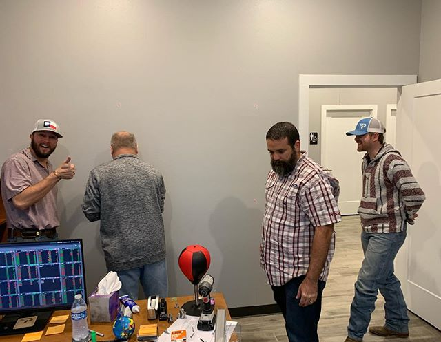 "How many Ops Support guys does it take to hang a new whiteboard? A lot, apparently! 😂 The new ""Annex"" office is coming together, thanks to all these handy guys hanging all the new whiteboards. #teamwork 😂"