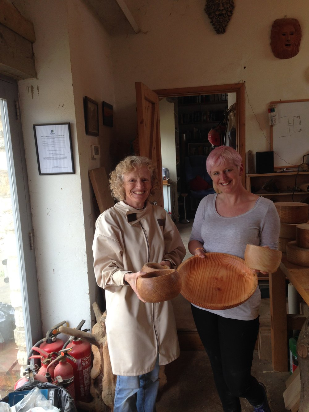 Mother & daughter at the end of a busy day wood turning for the first time.