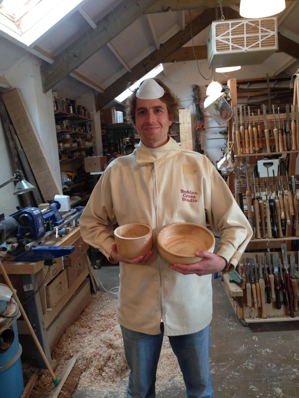 The dust mask is of course worn over the mouth when sanding - but doubles as a hat when posing for the portrait.