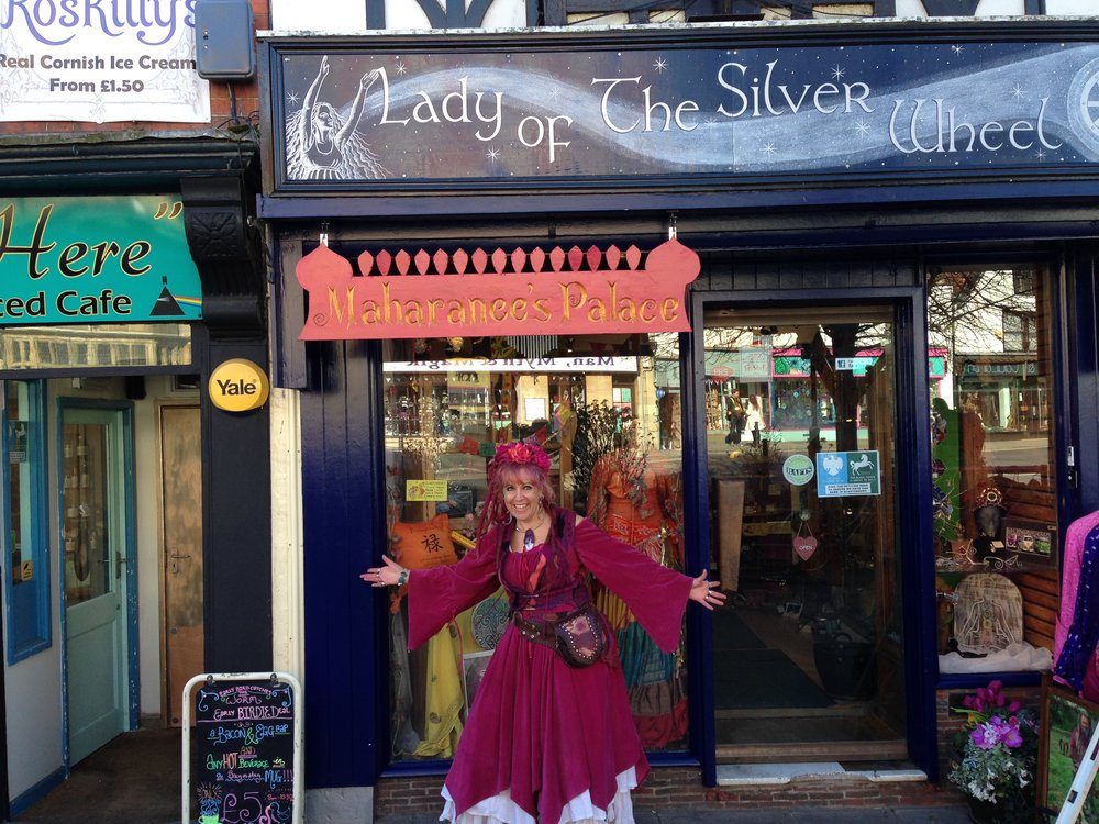 Glastonbury High Street shop sign - with owner