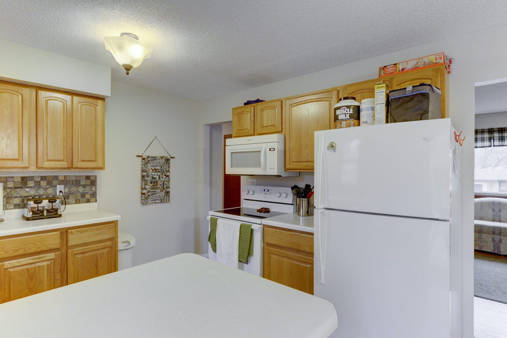 6734 Berkshire Ln N Maple-print-009-4-Kitchen-3000x2000-300dpi.jpg
