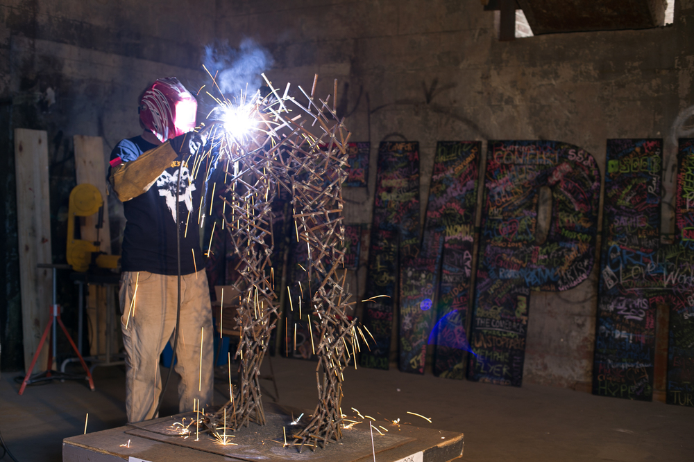 Elisha has spent the last four days welding his sculpture of the Greek god Apollo. Tennessee brewery brings in an artist every week to produce a piece of original art.