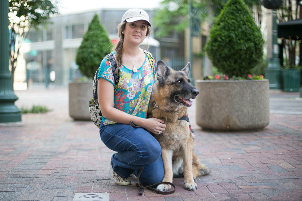 Ashley and Casch take a walk down south Main Street. Casch, a nine year old service dog, might be in retirement but he still sports his vest to get that special treatment he deserves.