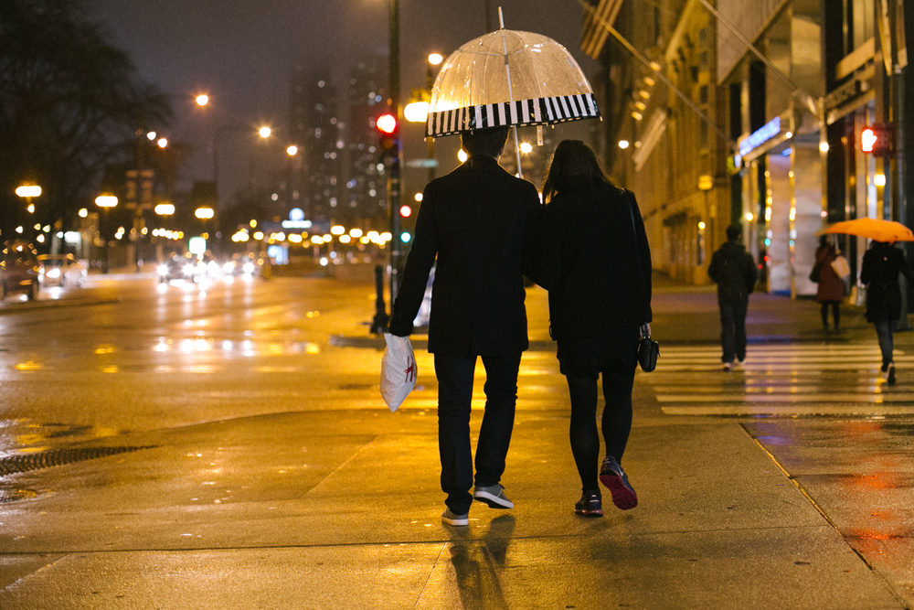 Update: halfway though and the rain is really coming down. Hun Ho and his girlfriend, Samantha share an umbrella on their way back to the dorms. 12/24