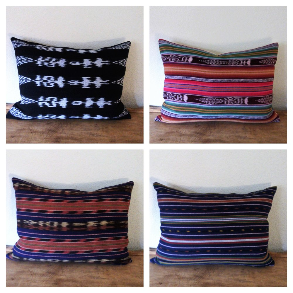 """Justa - Fair-trade hand woven cottons from Guatemala, backed with sturdy cotton. Constructed with an exposed brass zipper. Wash and dry cool.14"""" x 20"""" - $35Colors: black/white ikat, fuchsia stripe, orange/brown stripe, navy stripe"""